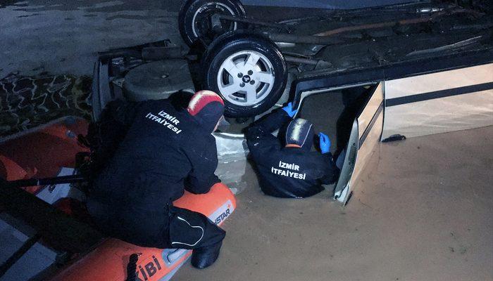 İzmir'de su dolan alt geçitten araç çıkarıldı